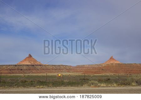 Bears Ears National Monument is a new national monument and is currently (2017) in danger of becoming privatized. Here is a picture of the north and south six shooter formations with farmland in the foreground.