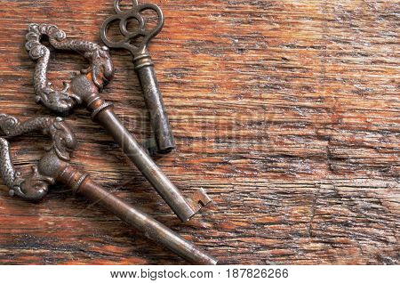 A close up image of three antique keys.