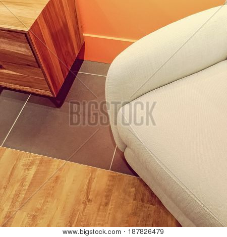 Interior detail with side table and armchair. Modern interior design.