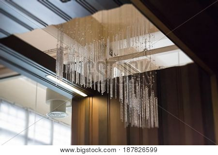 Crystal Line Mobiles Chandelier From Ceiling stock photo