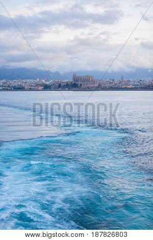 wake of ferry leaving mallorca spain