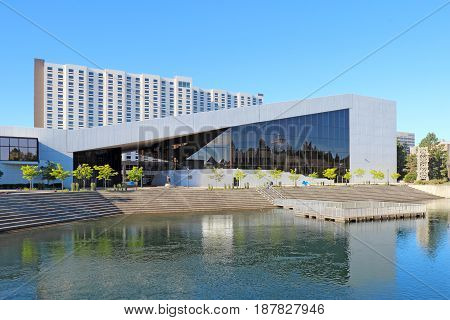 SPOKANE WASHINGTON - JUNE 3 2016: The INB Performing Arts Center and the Spokane River in Spokane Washington. This 2700-seat entertainment venue was built for the Expo World's Fair in 1974.