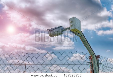 barbed wire and surveillance camera. A close up