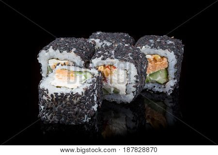 Japanese seafood rolls on a black background