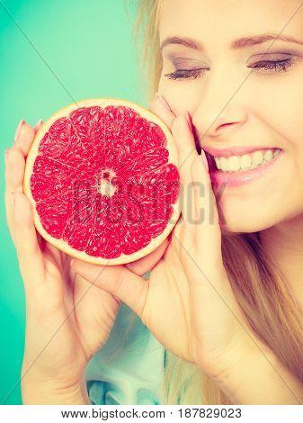 Woman Holds Grapefruit Citrus Fruit In Hands