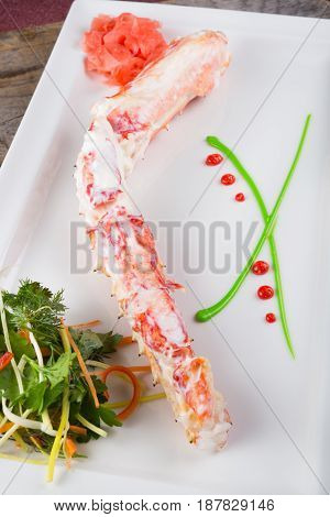 Prepared crab leg with ginger and herbs