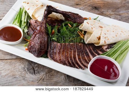 Traditional chinese peking duck dish sliced with sauce