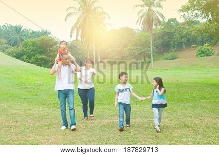 asian family outing and playing at outdoor park