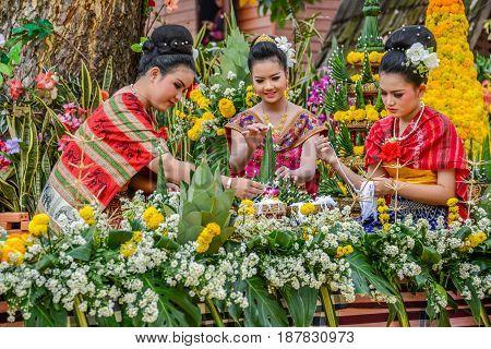 NAKORN PHANOM THAILAND - FEBRUARY 14 2015: Thai northeastern Phutai traditional liftstyle in making rice offering and garland for Phutai world cerebration event in Renunakorn of Nakorn Phanom Thailand.
