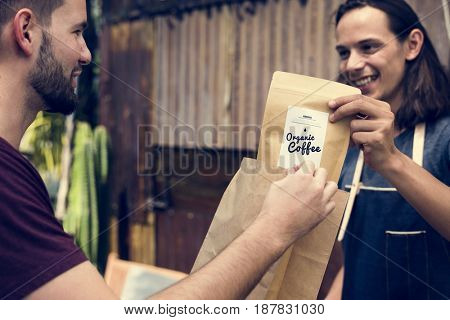 Man Selling Coffee Fresh Brew to People at Market