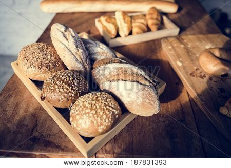 Variety of Fresh Baked Bakery on Wooden Table