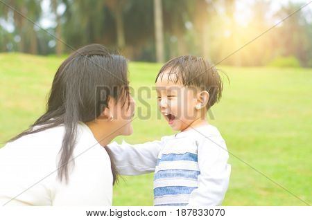 Asian mother and son playing at outdoor