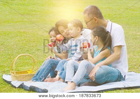 asian family having fun time at outdoor