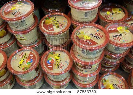 Varios Of Hummus Boxes On Shelf At Israeli Food Supermarket