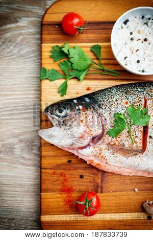 Photo of the raw trout on wooden background