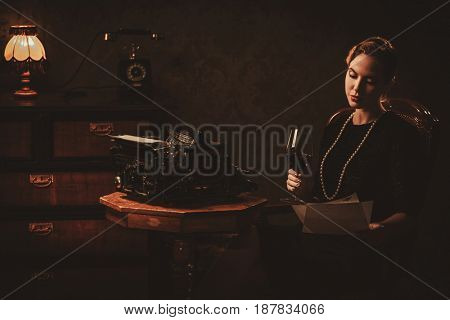 Beautiful young woman reading in retro interior