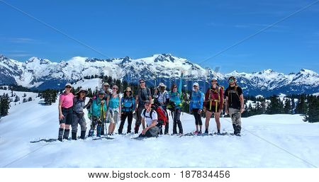 VANCOUVER, BC/CANADA - MAY 22, 2017: Group of friends on the trail to Elfin Lakes near Squamish. Snowshoeing in Sea to Summit.