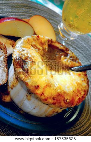 Bowl of French onion soup with apples and bread