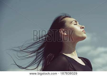 Woman With Closed Eyes Relaxing With Waving, Long Hair