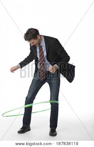 Caucasian businessman twirling plastic hoop