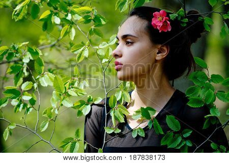 Youth, Beauty. Girl With Flower In Hair In Green Leaves