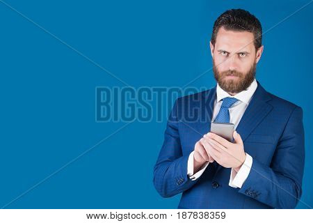 Serious Businessman Or Lawyer In Suit Hold Mobile Device