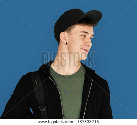 A teenager guy is smiling