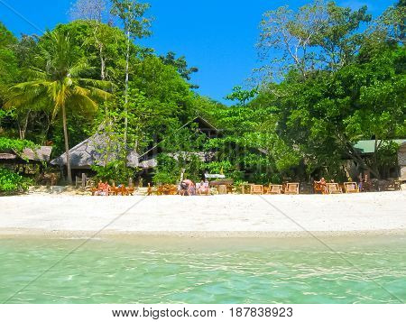 Phi Phi Islands, Thailand - February 04, 2010: The beach houses in Viking Resort at sunny day of Phi Phi Islands in the Andaman Sea, Thailand