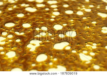 Close-up shot of highly pure and concentrated slab of shatter wax.