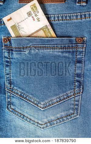One Cuban peso convertibles in jeans pocket closeup