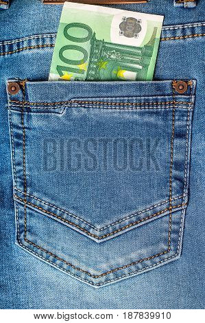 100 euro note in a blue jeans pocket. Financial concept