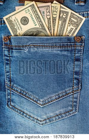 American dollar banknotes in jeans pocket closeup