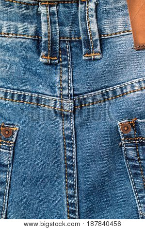 The texture of the colored cotton fabric. Stitched texture jeans background