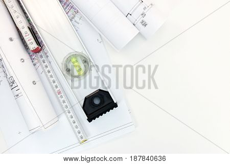Rolls Of Drawing Paper With Plans And Land-use Projects. Architect Workplace Top View.