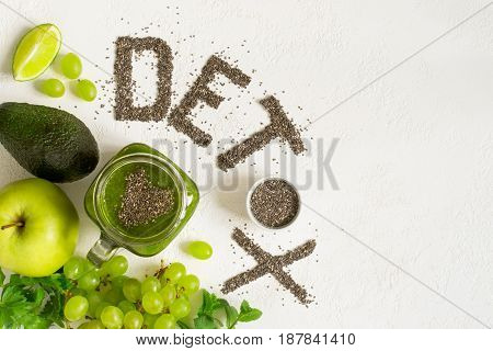 Word detox is made from chia seeds. Green smoothies and ingredients. Concept of diet cleansing the body healthy eating. Top view with copy space