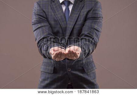 The Man In The Suit Stretched Out His Arms