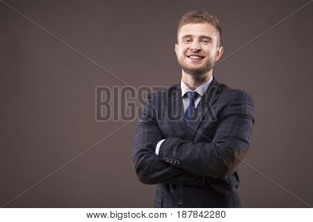 Man Stands With His Arms Crossed