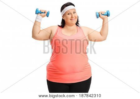 Overweight woman exercising with small dumbbells isolated on white background