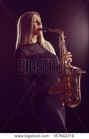Female jazz musician performing on a saxophone