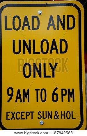 Load and unload only sign displayed outdoors.