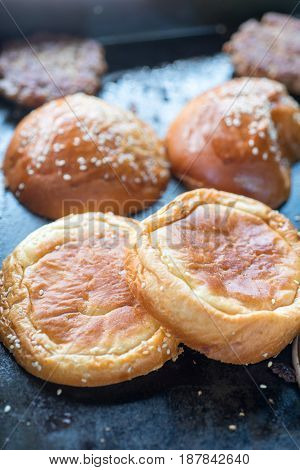 Sesame Seed Buns Heating On A Grill
