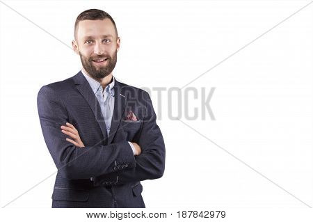 Man stands with his arms crossed and smiling