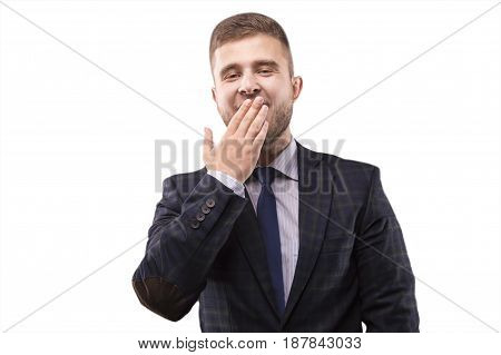 Man in a suit tired and yawns