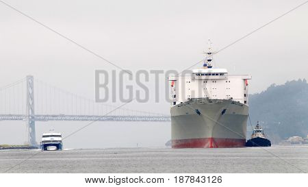 Oakland CA - May 23 2017: Matson cargo ship MANOA entering the Port of Oakland the fifth busiest port in the United States.