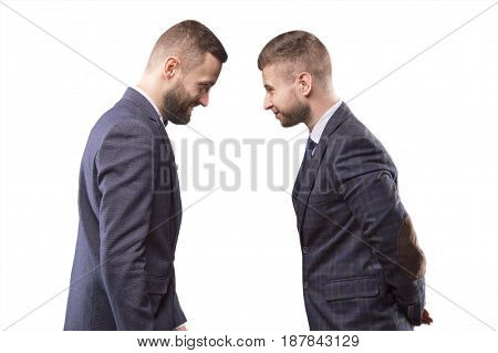 Two men in suits butting each other and smiling