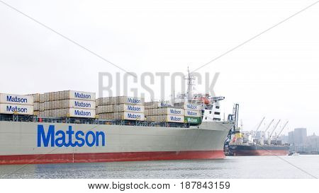 Oakland CA - May 23 2017: Matson cargo ship MANOA maneuvering into the Port of Oakland. Matson provides shipping services Pacific wide. Mainly to and from the Hawaiian Islands.