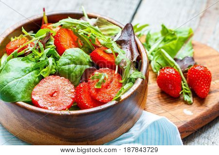Summer bright salad with strawberries. Weight loss on a vegan diet concept.