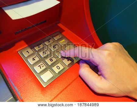 Atm Machine Red Color And Finger Hand Close-up.