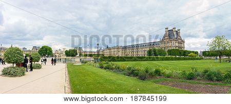 Paris France - May 2 2017: Panorama views of the Louvre buildings in the main courtyard (Cour Napoleon) of Louvre Museum views from the Garden of the Tuileries on May 02 2017 in Paris France.