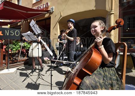 VILNIUS LITHUANIA - MAY 20: Unidentified musician play violin and other instrumnts in Street Music Day on May 20 2017 in Vilnius. Its a most popular event on May in Vilnius Lithuania